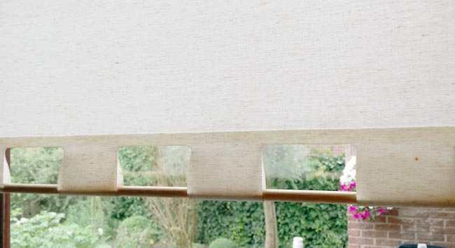 Rolgordijn schoonmaken raamdecoratie weer wit krijgen